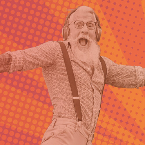 Bearded man with his mouth open, leaping into the air, wearing earphones